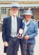 C.A.R. Hoare and his wife stand outside Buckingham Palace after he was knighted by the queen