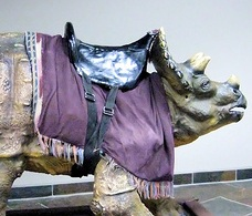 Statue of triceratops with a saddle from the Creation Museum