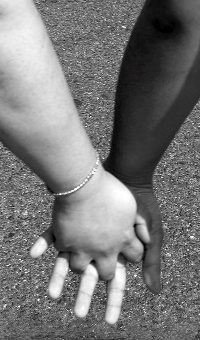 Black and white hands, clasped